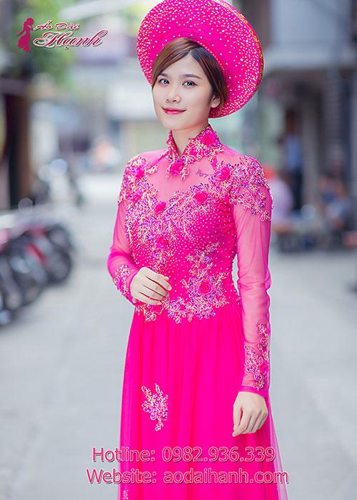 Áo dài cưới màu hồng sen kết hợp với ren hoa nổi 3d tinh xảo