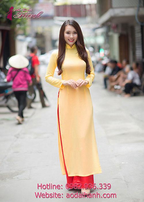 Áo dài lễ tân vàng chiffon tay dài cổ truyền thống
