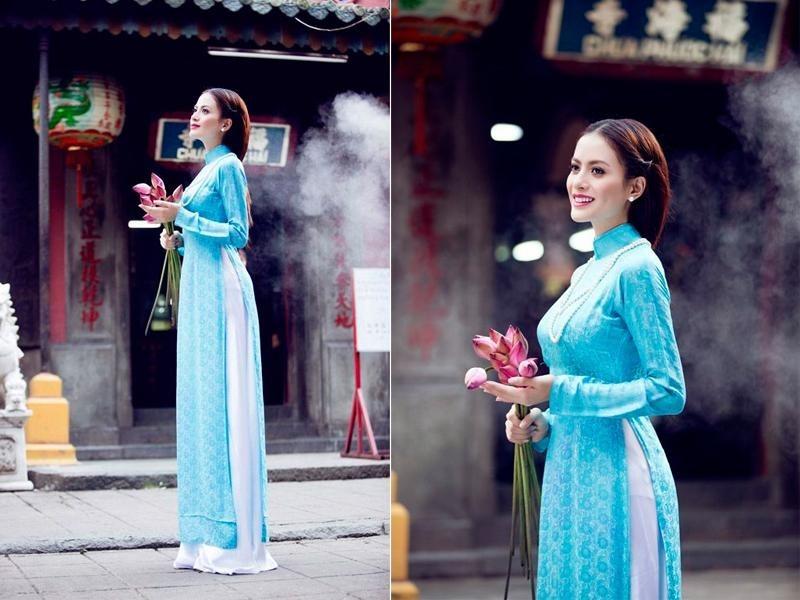 áo dài màu xanh ngọc bích mang đến cảm giác dịu dàng, bình yên