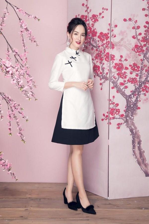 Loại váy xòe trơn cũng có thể kết hợp với áo dài