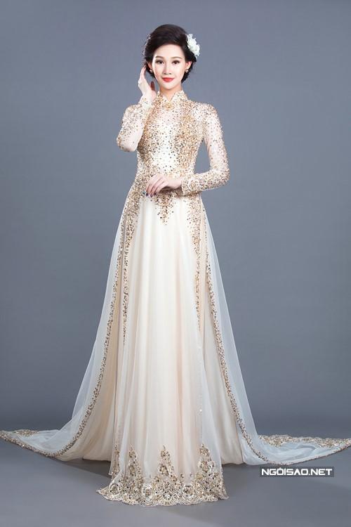 Mẫu áo dài cưới đính đá ánh vàng vô cùng tinh tế